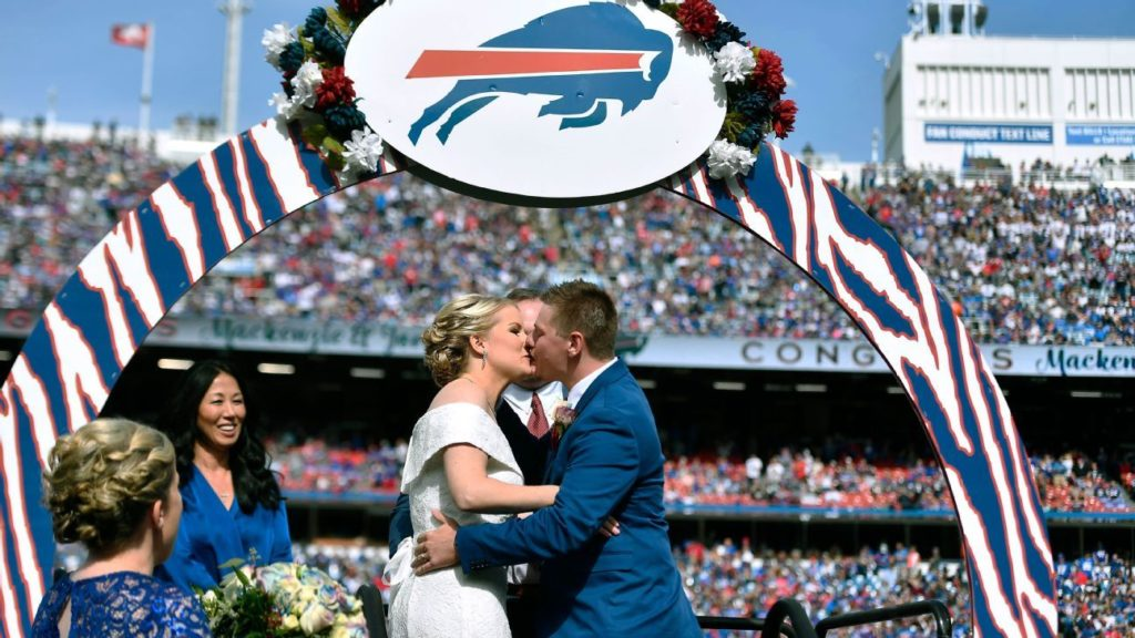 Couple married during Bills halftime off to Miami...